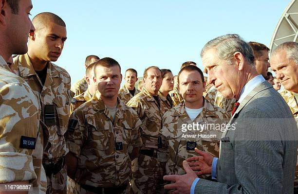 Prince Charles Prince of Wales meets a detachment of RAF Tornado aircrew and RAAF aircrew when he visits the US Airbase Al Udeid outside Doha in...