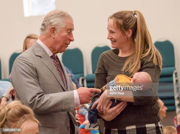 Prince Charles Prince of Wales meets Amelia Kerr and her son Oliver as he opens The Dorchester Community Church which has recently relocated to a new...