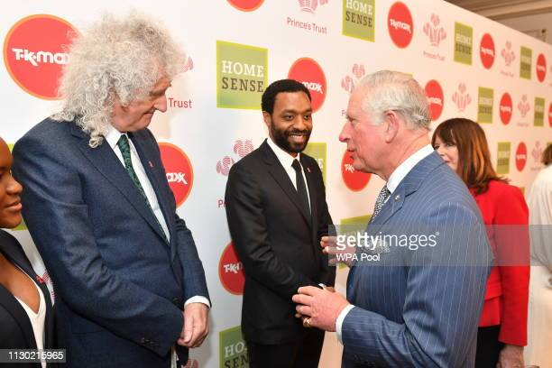 Prince Charles Prince of Wales meets Brian May and Chiwetel Ejiofor at the annual Prince's Trust Awards at the London Palladium on March 13 2019 in...