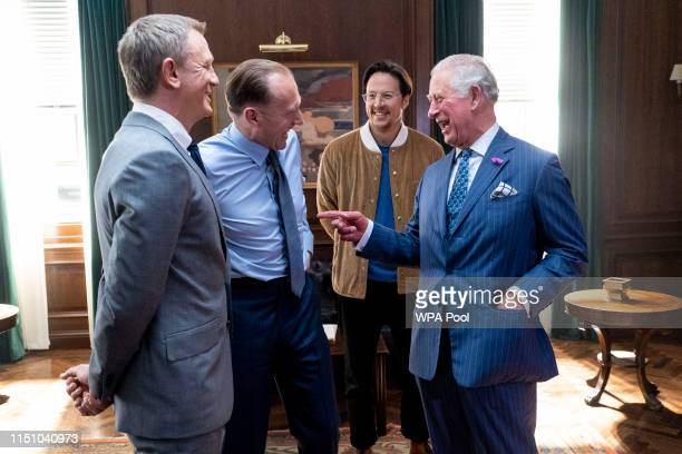 Prince Charles , Prince of Wales meets British actors Ralph Fiennes , Daniel Craig and US Director Cary Joji Fukunaga as he tours the set of the 25th...