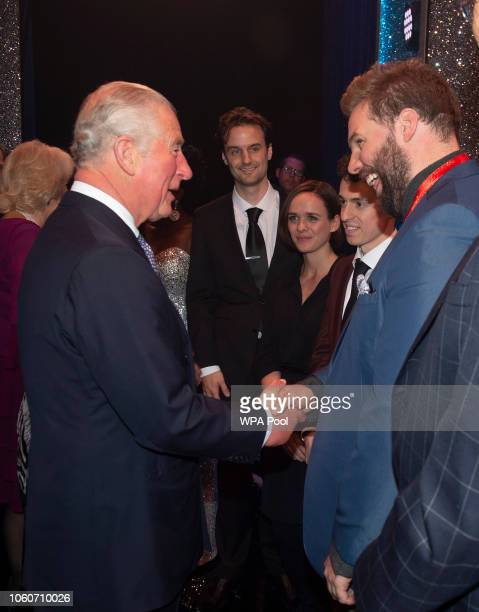 Prince Charles Prince of Wales meets cast members after attending a one off performance of 'We Are Most Amused and Amazed' in aid of The Prince's...