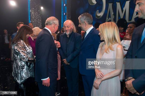 Prince Charles Prince of Wales meets cast members Bill Bailey Rowan Atkinson and Kylie Minogue after attending a one off performance of 'We Are Most...