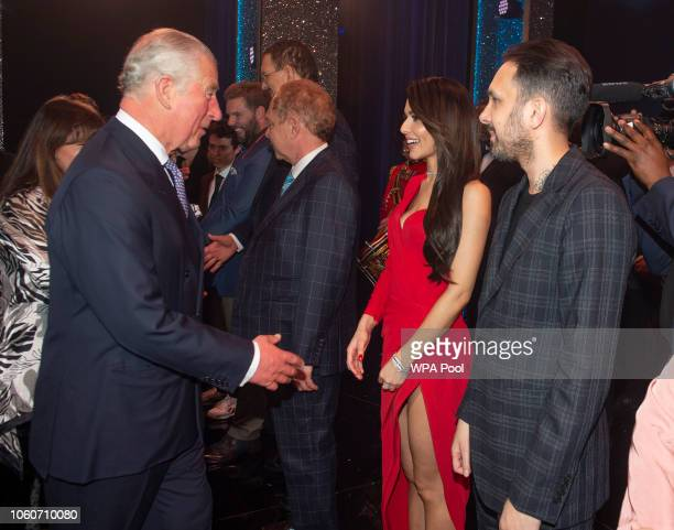 Prince Charles Prince of Wales meets cast members Cheryl Cole and Dynamo after attending a one off performance of 'We Are Most Amused and Amazed' in...