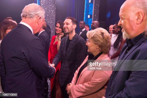 Prince Charles Prince of Wales meets cast members Cheryl Cole Dynamo Sandi Toksvig and Bill Bailey after attending a one off performance of 'We Are...