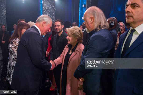 Prince Charles Prince of Wales meets cast members Dynamo Sandi Toksvig Bill Bailey and Rowan Atkinson after attending a one off performance of 'We...