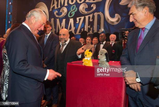 Prince Charles Prince of Wales meets cast members Omid Djalili puppets Sooty and Sweep and Jim Carter after attending a one off performance of 'We...