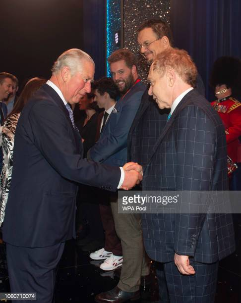 Prince Charles Prince of Wales meets cast members Penn and Teller after attending a one off performance of 'We Are Most Amused and Amazed' in aid of...
