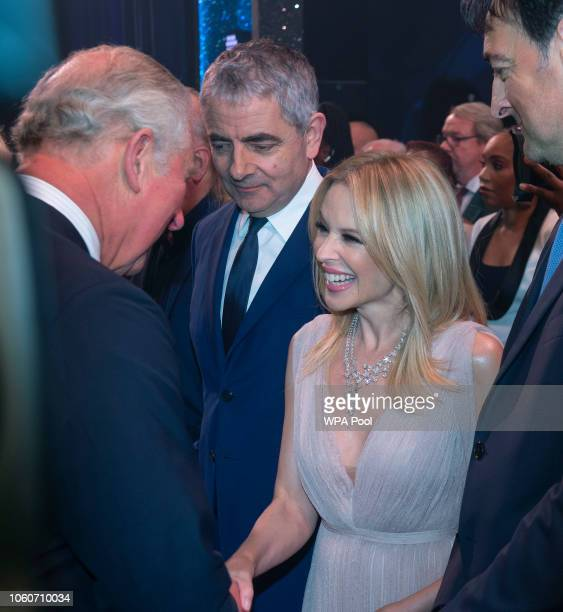 Prince Charles Prince of Wales meets cast members Rowan Atkinson and Kylie Minogue after attending a one off performance of 'We Are Most Amused and...