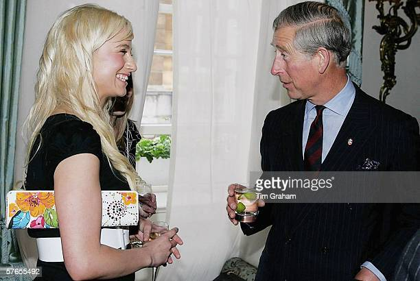 Prince Charles Prince of Wales meets Chantelle Houghton at a reception at Clarence House for those supporting a concert to celebrate the 30th...