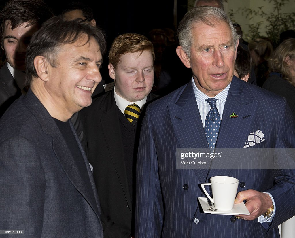 Prince Charles, Prince of Wales meets chef Raymond Blanc at a reception during an official visit to Carshalton Boys Sports college with Jamie Oliver to see how the school has transformed its approach to healthy eating on November 26, 2012 in Carshalton, England.