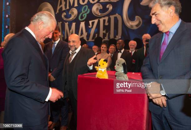 Prince Charles Prince of Wales meets comedian Omid Djalili puppets Sooty and Sweep and actor Jim Carter after attending a one off performance of 'We...