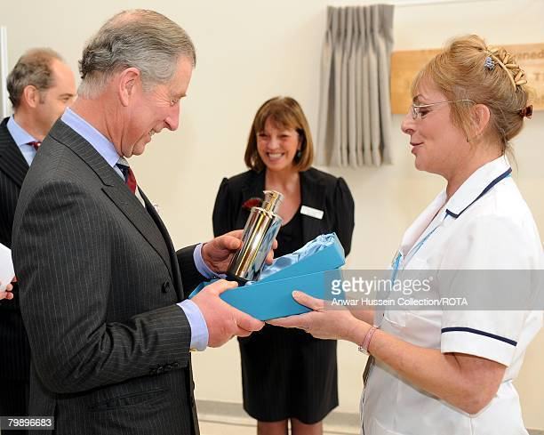 Prince Charles Prince of Wales meets Conrad Samuel receives a silver alcoholic hand gel dispenser when he opens the new Central Middlesex Hospital on...