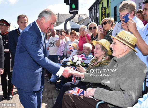 Prince Charles Prince of Wales meets elderly residents on his visit to the village market on May 10 2017 in Dromore Northern Ireland Their Royal...