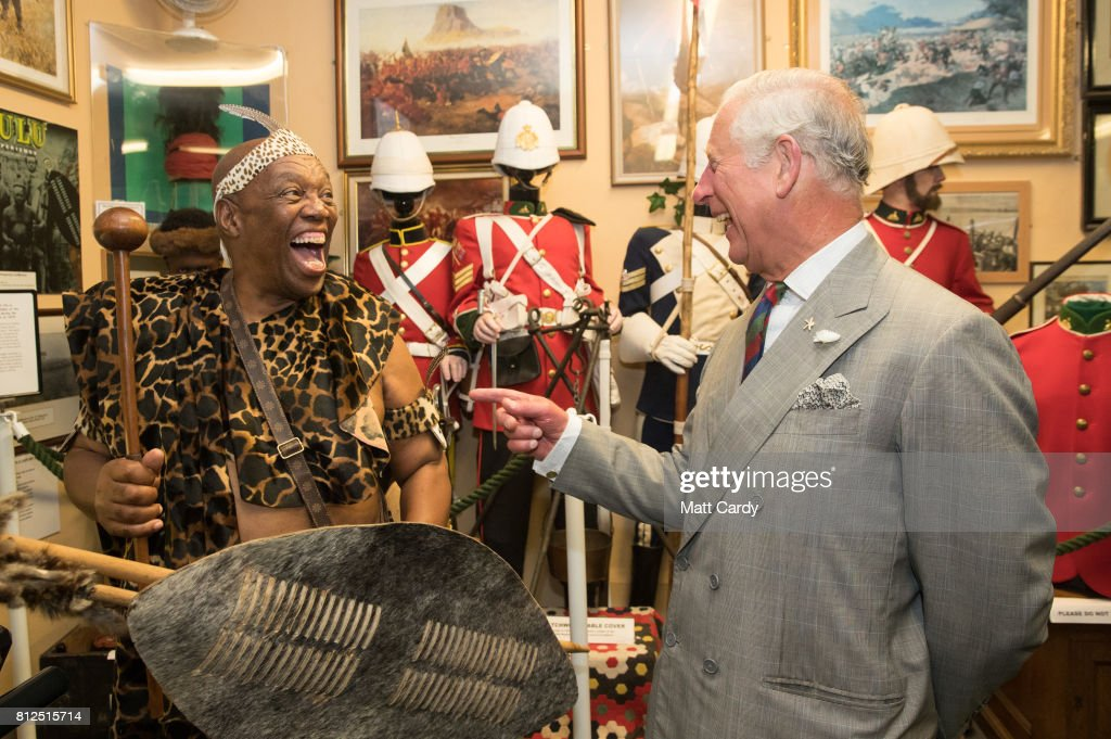 Prince Charles, Prince of Wales meets Elliot Ngubane dressed in traditional Zulu costume at the Royal Welsh Regimental Museum during The Prince of Wales' annual Summer visit to Wales on July 11, 2017 in Brecon, Wales.