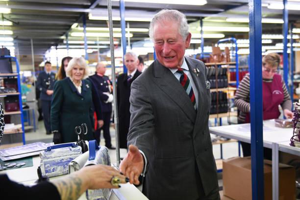 Prince Charles Prince of Wales meets employees during a visit to The Cambridge Satchel Company where he toured the company's workshops and met staff...