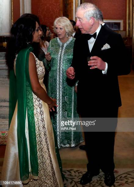 Prince Charles Prince of Wales meets former cricketer Isa Guha during the British Asian Trust Dinner at Buckingham Palace on February 5 2019 in...