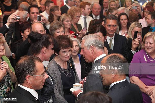Prince Charles Prince of Wales meets guests during his 64th birthday celebration who are also celebrating their birthday at Government House on...