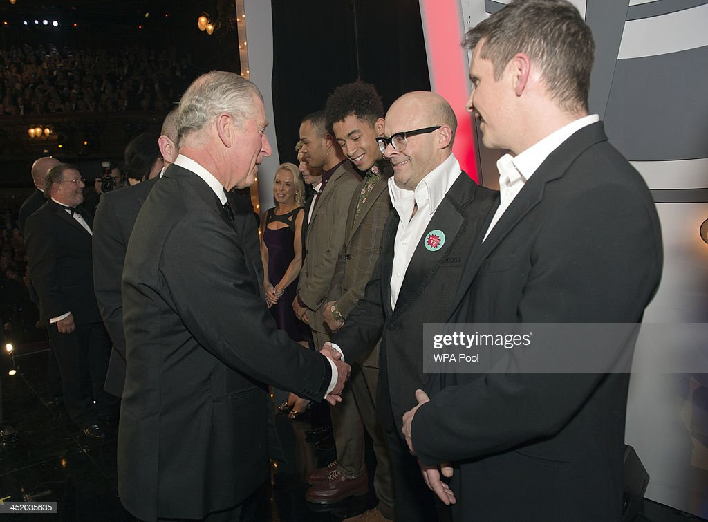 Prince Charles, Prince of Wales meets Harry Hill at the Royal Variety Performance at London Palladium on November 25, 2013 in London, England.