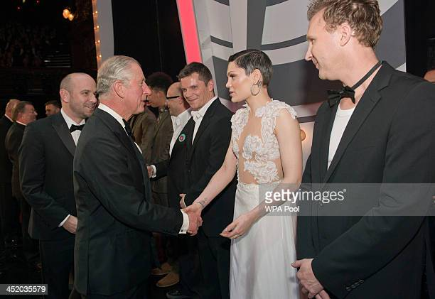 Prince Charles Prince of Wales meets Jessie J and Jason Byrne at the Royal Variety Performance at London Palladium on November 25 2013 in London...