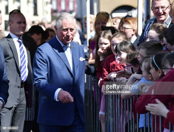 Prince Charles Prince of Wales meets local school children on his visit to the village market on May 10 2017 in Dromore Northern Ireland Their Royal...