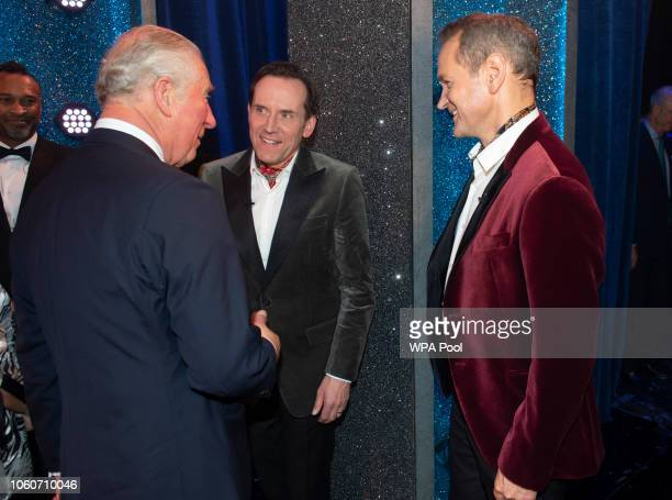 Prince Charles Prince of Wales meets meets cast members Ben Miller and Alexander Armstrong after attending a one off performance of 'We Are Most...