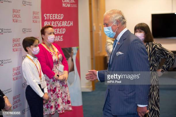 Prince Charles, Prince of Wales meets Oscar Coulson-Starley and mother Danni Starley from Kent during a visit to the Breast Cancer Now Toby Robins...