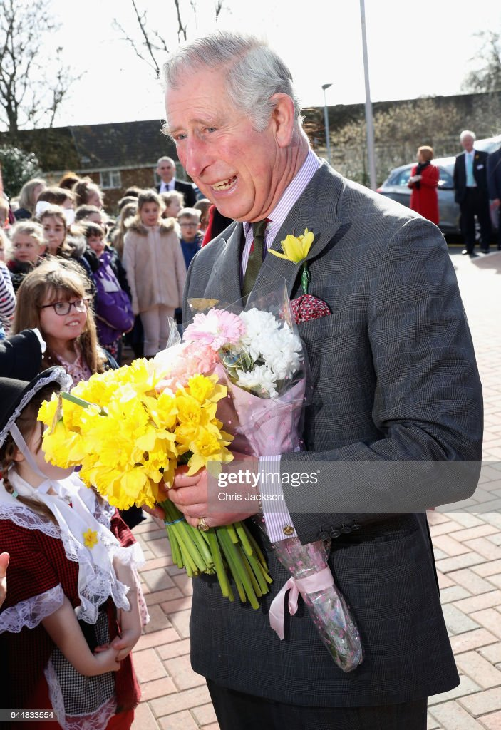 Prince Charles, Prince of Wales meets parents and members of the public after taking part in a climate change education programme run by the charity, Size of Wales, at Blenheim Road Community Primary, on February 24, 2017 in Cwmbran, United Kingdom.