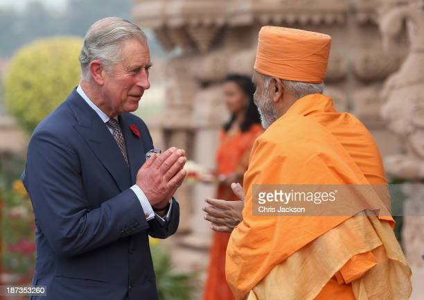 Prince Charles Prince of Wales meets priests outside the Akshardham Temple during day 3 of an official visit to India on November 8 2013 in Delhi...