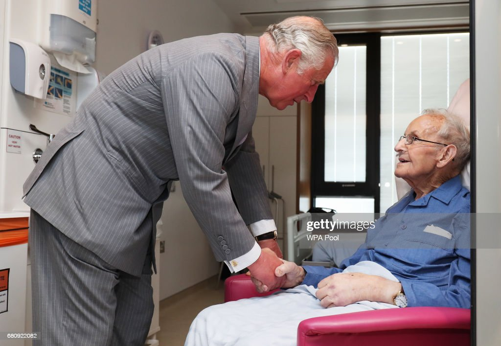 Prince Charles, Prince of Wales meets Robert Mawhinney on a tour of the North West Cancer Centre at Altnagelvin Hospital during a visit to Northern Ireland on May 9, 2017 in Londonderry, Northern Ireland.