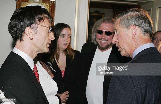 Prince Charles Prince of Wales meets Robin Gibb and Barry Gibb at a reception at Clarence House for those supporting a concert to celebrate the 30th...