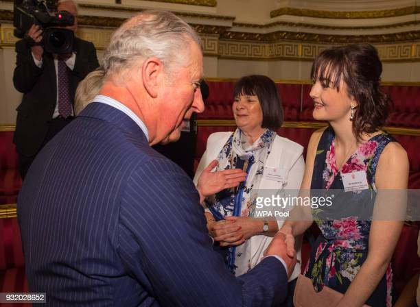Prince Charles Prince of Wales meets Royal College of Nursing Student Nurse of the Year Zoe Butler and Elaine Perry of Macmillan Cancer Support at a...