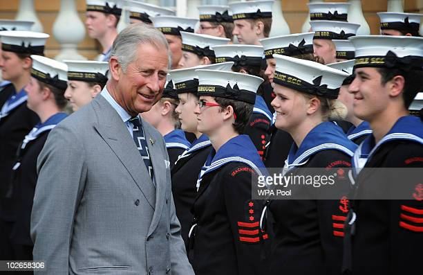 Prince Charles Prince of Wales meets Royal Navy cadets during a garden party to mark the 150th anniversary of the Cadet Forces in the grounds of...