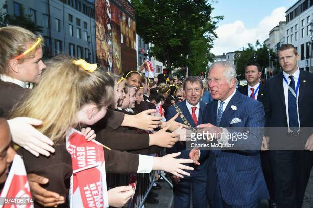 Prince Charles Prince of Wales meets school children during a visit to the English Market on June 14 2018 in Cork Ireland The Prince of Wales and...