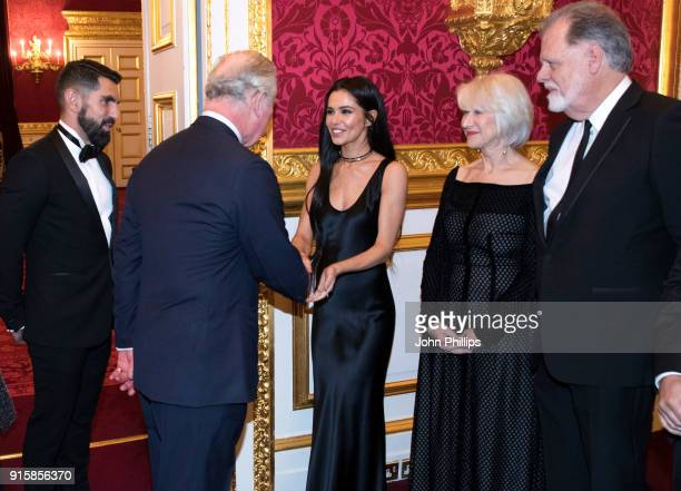 Prince Charles Prince of Wales meets singer Cheryl Tweedy actress Dame Helen Mirren and director Taylor Hackford as he attends the Prince's Trust...