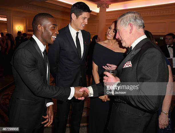 Prince Charles, Prince of Wales meets singer Tinie Tempah , presenter Vernon Kay and his wife Tess Daly at a reception for the Prince's Trust Invest...