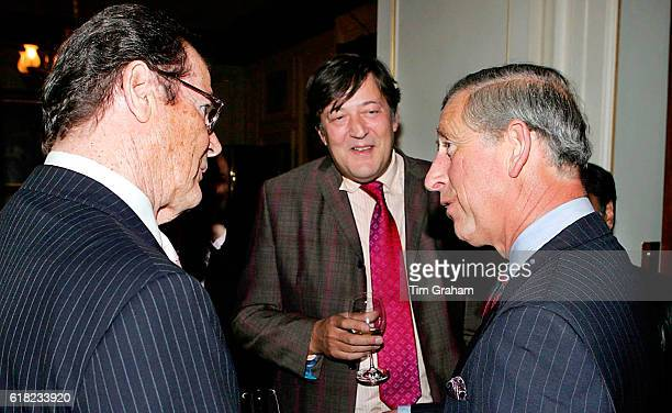 JUNE 2006*** Prince Charles Prince of Wales meets Sir Roger Moore and Stephen Fry at a reception at Clarence House for those supporting a concert to...