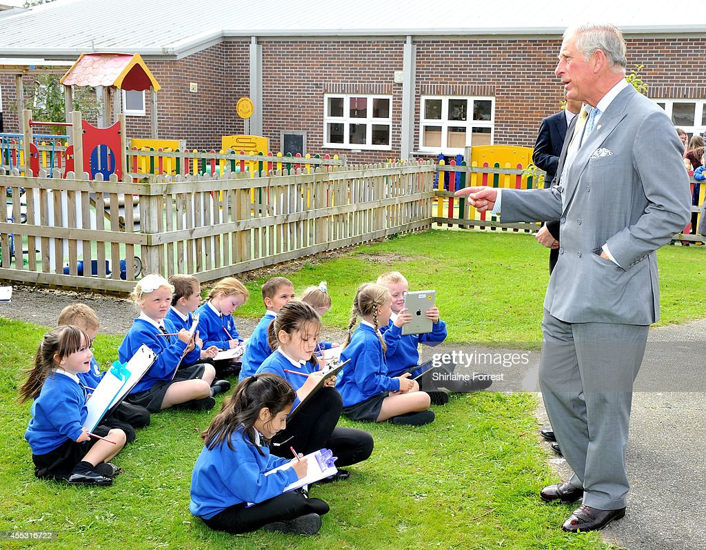 Prince Charles, Prince of Wales & Duchess Of Cornwall Visit Lache Primary School, Chester : News Photo