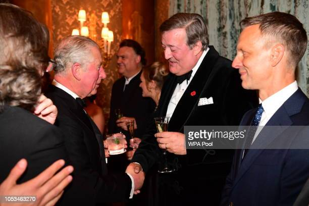 Prince Charles, Prince of Wales meets Stephen Fry as he attends a Gala Concert at The Royal Opera House to mark Prince Charles's 70th birthday on...
