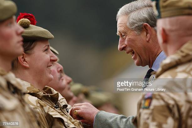 Prince Charles Prince of Wales meets Territorial Army soldiers during a ceremony to present the soldiers from 51st Highland 7th Battalion The Royal...