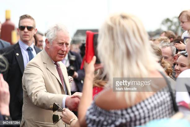 Prince Charles Prince of Wales meets the general public before taking a tour of the Bundaberg Rum Distillery on April 6 2018 in Bundaberg Australia...