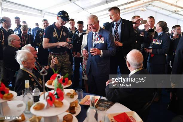 Prince Charles Prince of Wales meets veterans during the Dday 75 Commemorations on June 05 2019 in Portsmouth England The political heads of 16...