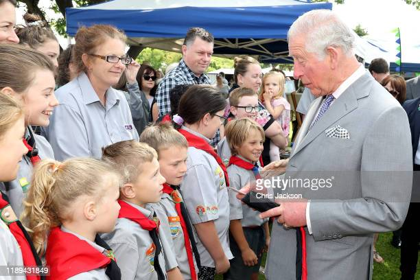 Prince Charles, Prince of Wales meets with a scout group as he visits Lincoln Farmer's and Craft Market on November 23, 2019 in Christchurch, New...