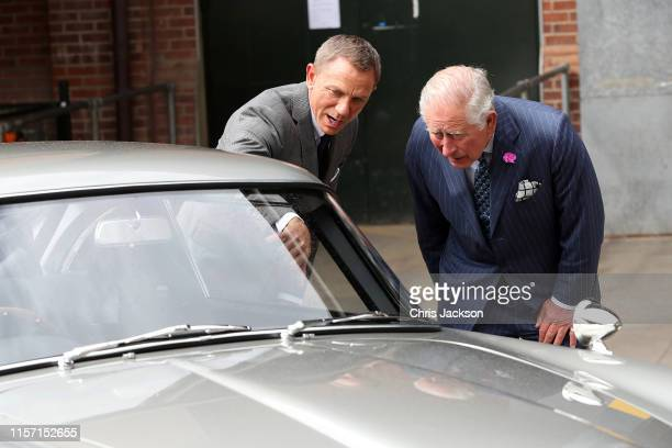 Prince Charles, Prince of Wales meets with actor Daniel Craig during a visit to the James Bond set at Pinewood Studios on June 20, 2019 in Iver...