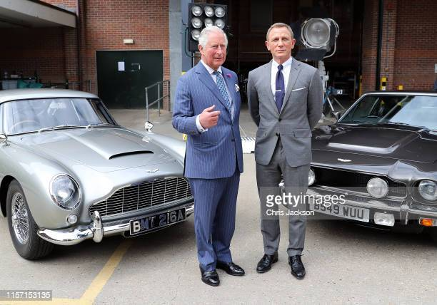 Prince Charles Prince of Wales meets with actor Daniel Craig during a visit to the James Bond set at Pinewood Studios on June 20 2019 in Iver Heath...