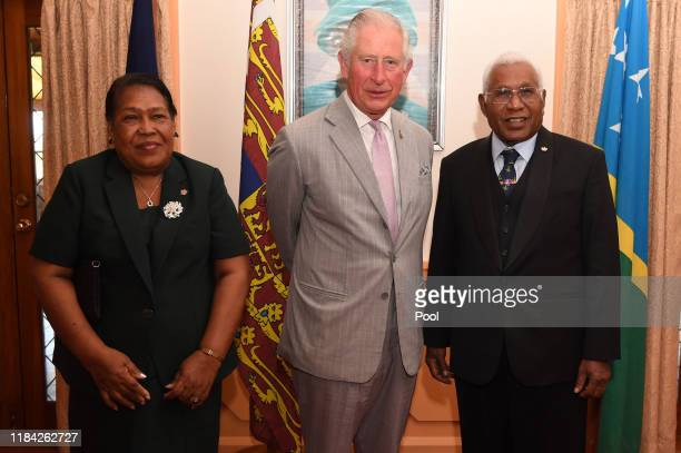 Prince Charles Prince of Wales meets with Lady Mary Vunagi and GovernorGeneral Right Reverend Sir David Vunagi at Government House in Honiara Solomon...