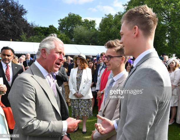 Prince Charles Prince of Wales meets YouTube vloggers Joe Sugg and Casper Lee as they attend a Buckingham Palace Garden Party at Buckingham Palace on...