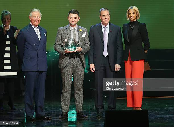 Prince Charles Prince of Wales on stage Rising Star Award winner Faisal Ahmed and Alesha Dixon during the Prince's Trust Celebrate Success Awards at...
