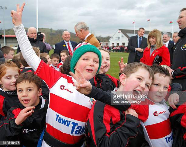 Prince Charles Prince of Wales Patron of Llandovery Rugby Club meets members of club's youth team after watching them take part in a practice session...