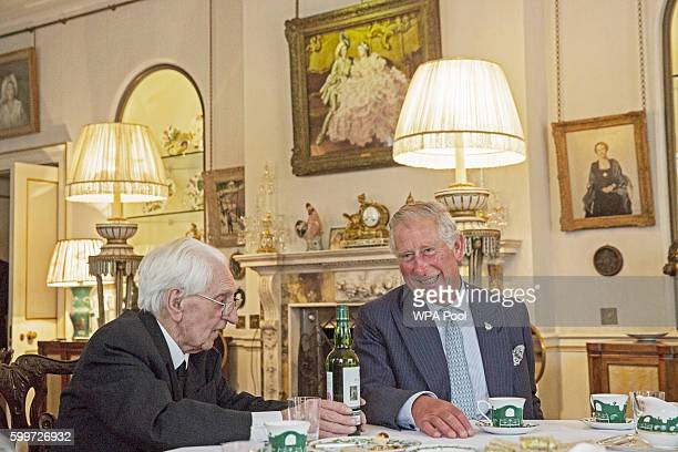 Prince Charles Prince of Wales Patron of The Battle of Britain Fighter Association speaks with Flight Officer Ken Wilkinson and a bottle of Highgrove...