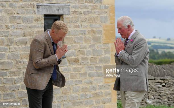Prince Charles Prince of Wales patron of the Rare Breeds Survival Trust right is greeted by farmer and television personality Adam Henson with a...